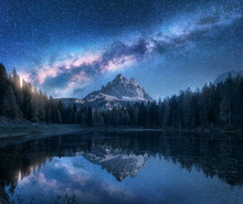 Milky Way Over Antorno Lake At Night. Summer Landscape With Alpine Mountains, Trees, Blue Sky With Milky Way And Stars, Beautiful Reflection In Water, High Rocks. Dolomites, Italy. Space And Nature