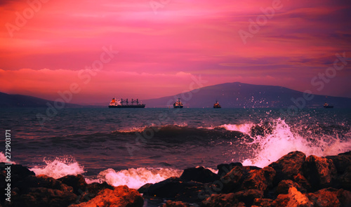Photo Stands Candy pink Red sunset over the black sea, mountains, purple sky. Summer sea scenic landscape in stormy evening