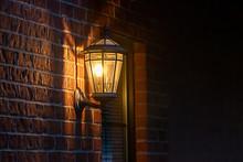 Old Fashoned Glass Wall Mounted Lantern On A Brick Wall