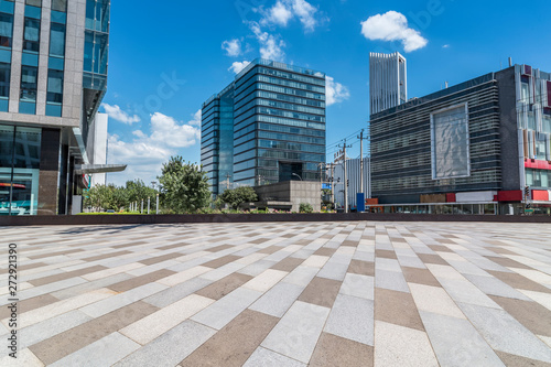 Panoramic skyline and modern business office buildings with empty road,empty concrete square floor #272921390
