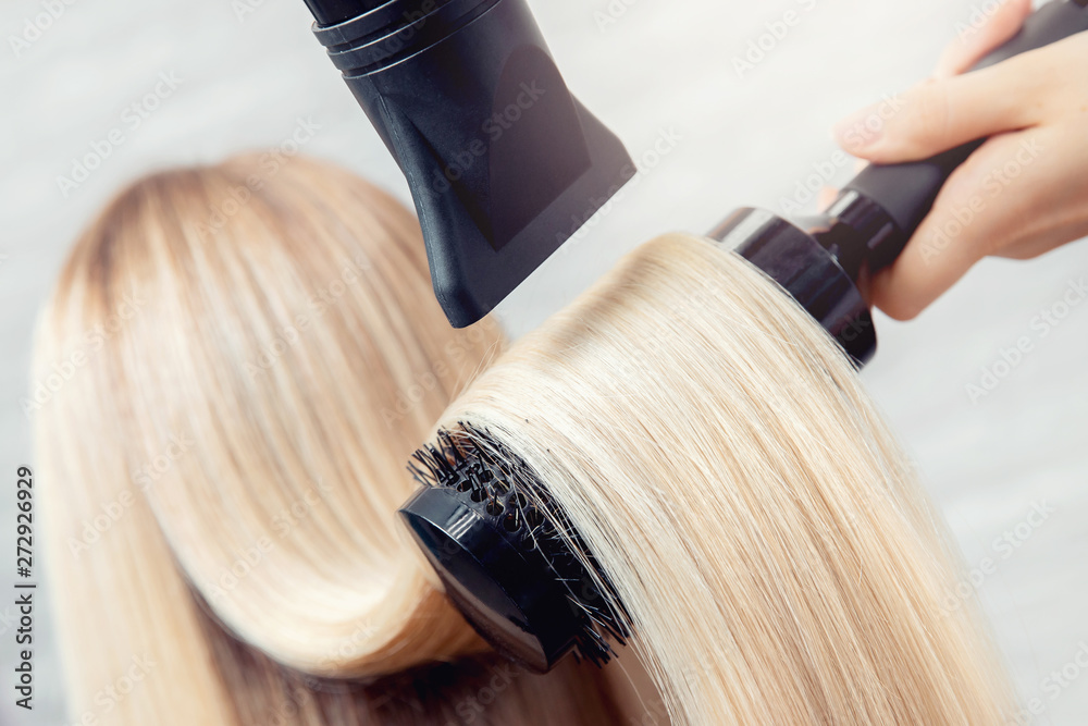 Fototapeta Close-up of hair dryer, concept cut salon, female stylist