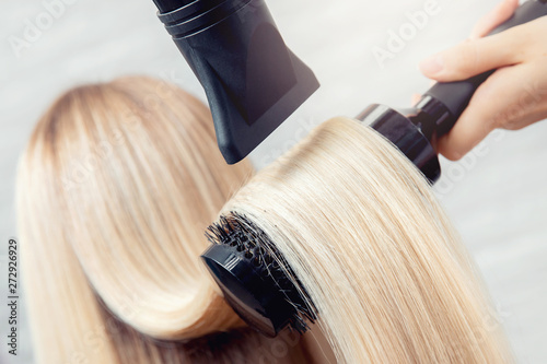 Close-up of hair dryer, concept cut salon, female stylist