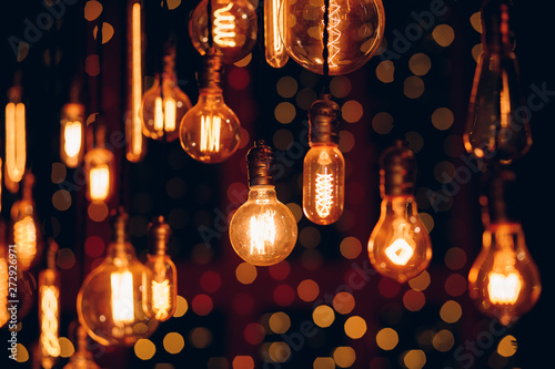 Slika na platnu Set edison retro lamp on dark bokeh background