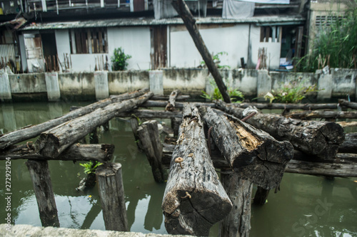 Aluminium Prints Mills Old wood rotted along the canal somewhere in Thailand