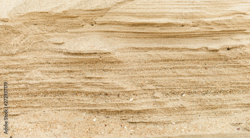 Layers of sand on the beach, soft sandstone at the shore Canvas Print
