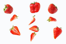 Pieces And Whole Strawberries Isolated On A White Background In A Chaotic Manner .