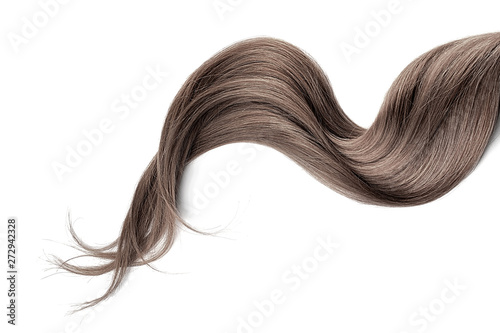 Photo Brown hair isolated on white background. Long wavy ponytail