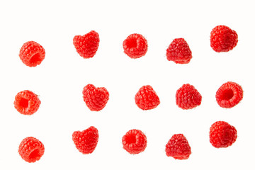 raspberry berries isolated on a white background in a chaotic manner .