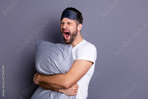 Portrait of his he nice-looking attractive exhausted sleepy bearded guy holding Canvas Print