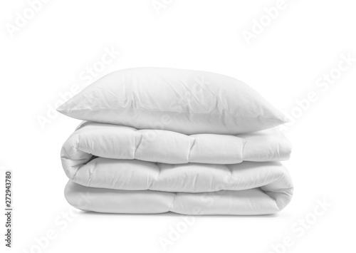 Fotografie, Obraz White pillow on the duvet isolated, folded beddings on the white background, bed