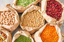 Bags With Different Legumes On Table
