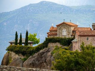 Fototapeta na wymiar The St. Stephen's Monastery and beautiful landscapes of Meteora and blue sky, Kalambaka, Greece