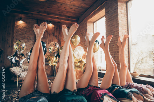 Foto auf AluDibond Pediküre Cropped nice crossed well-groomed legs attractive lovely fascinating luxurious feminine ladies lying on bed festal celebratory preparation in loft industrial style interior room house
