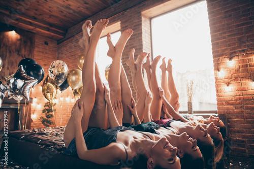 Nice attractive fascinating feminine ladies lying on bed crossed well-groomed le Wallpaper Mural