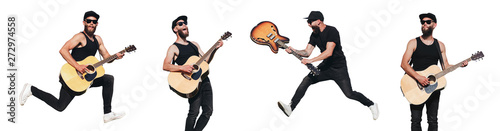 Obraz Guitar player isolated over white background. He is singing, screaming and jumping. Hipster guitar player with beard and black clothes - fototapety do salonu