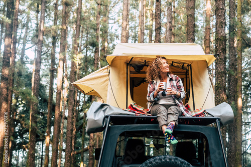 Vászonkép Happy hipster traveler people enjoying the alternative vacation - car with tent
