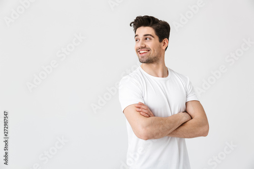 Obraz Happy young excited emotional man posing isolated over white wall background. - fototapety do salonu