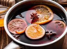 Pot Of Hot Wine With Citrus Sl...