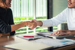 Business people shaking hands at meeting or negotiation, close-up