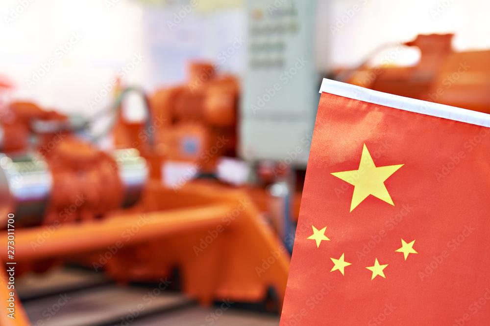 Fototapeta Chinese flag on industrial equipment