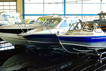 Fishing Boat. Motor Boat For Sale In The Store. Located On A Wheeled Cart