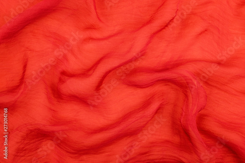 Fototapeta  Texture of the red soft chiffon fabric with folds