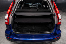Close Up Rear View Of A SUV  Blue Car With Open Trunk In Garage. Empty Car Trunk