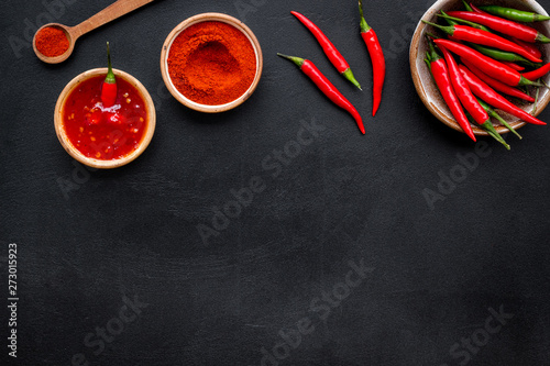 Cadres-photo bureau Hot chili Peppers Cooking hot food with chilli pepper on black table background top view copy space