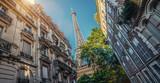 Fototapeta Fototapety z wieżą Eiffla - Paris street with view on the famous paris eiffel tower on a sunny day with some sunshine