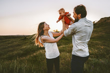 Happy Family Walking With Infant Baby Outdoor Mother And Father Parents Lifestyle Traveling Summer Vacations Together