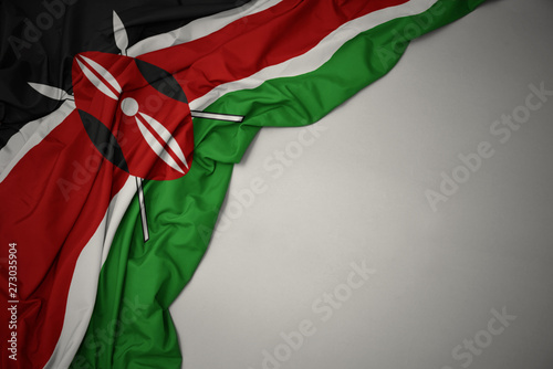 waving national flag of kenya on a gray background. Tableau sur Toile