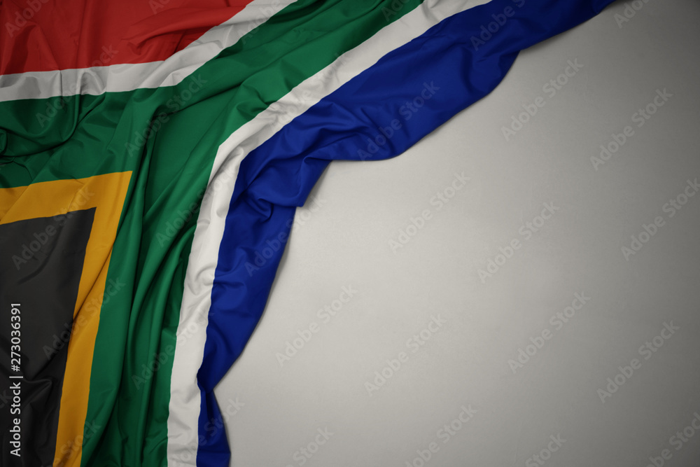 Fototapety, obrazy: waving national flag of south africa on a gray background.
