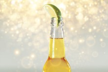 A Cold Beer With Lime On An Abstract Light Background