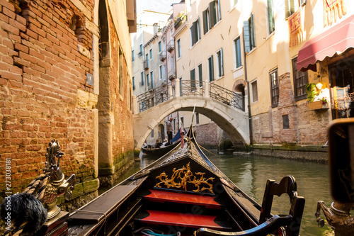 View of the Grand Canal from a gondola in Venice, Italy.
