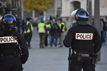 Helmeted Police Officers Photographed From Behind During A Protest