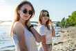 portrait of two young beautiful girls on the beach