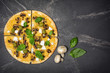 Pizza with mushrooms, cheese, olives and basil