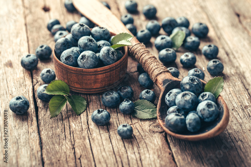 Blueberries in wooden spoon on old wood table Wallpaper Mural