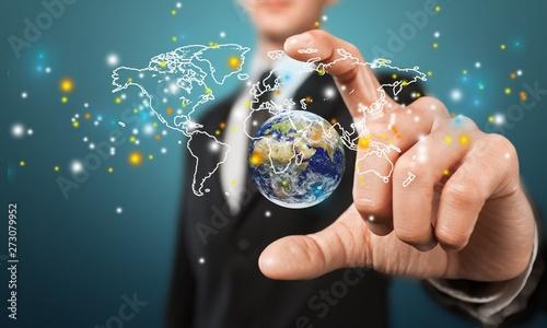 Fototapeta Close up of businessman holding digital globe in palms obraz na płótnie