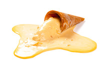 Side View Mango Flavor Ice Cream Cone In A Melting Process On White With Clipping Path
