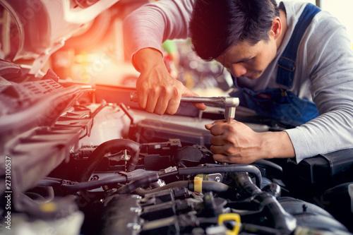 Fototapeta Professional car mechanic check engine car in car garage obraz