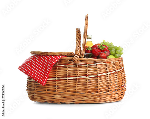 Fotografiet Picnic basket with fruits and lemonade isolated on white