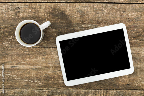 Digital tablet  on a wooden table. Calligraphy and lettering mockup. Flat lay