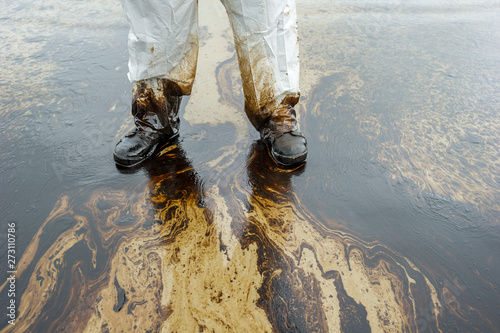 Photo  Petroleum spill mixed with other chemical substances on sea and sand surface