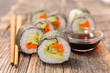 maki sushi with rice and vegetable and sauce