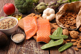health food assortment, salmon, almond, bean, broccoli, celeral - 273112549