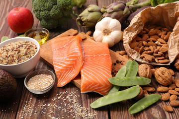 health food assortment, salmon, almond, bean, broccoli, celeral