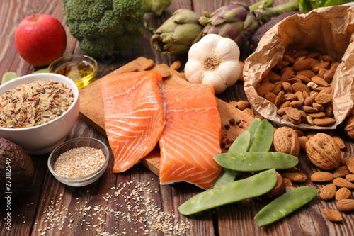 health food assortment, salmon, almond, bean, broccoli, celeral