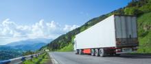 White Truck Arriving On Asphal...