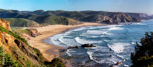 Canvas Prints Blue jeans Praia do Amado in the Costa Vicentina natural park at the Atlantic Ocean at the Algarve, Portugal.